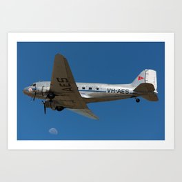 A DC-3 and the moon Art Print