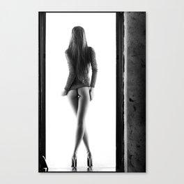 Woman standing in doorway Canvas Print