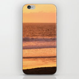 Surfer watching sunset in Southern California iPhone Skin
