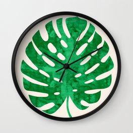 Watercolor tropical leaf on pink background Wall Clock