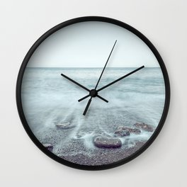 Minimalist misty seascape with rocks at long exposure Wall Clock