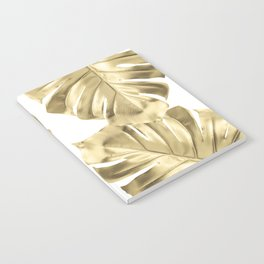 Gold Monstera Leaves on White Notebook