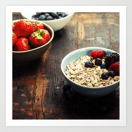 Bowls with cereals and fresh berries on wooden table Art Print