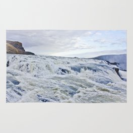 Closeup of the Rushing Waters Falling Down the Rocks of Gullfoss Waterfall in Iceland Rug
