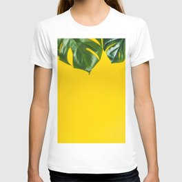 Tropical leaves on yellow background, space for text T-shirt