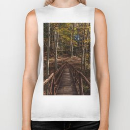 Wooden bridge crosses the forest lit by the autumn sun Biker Tank
