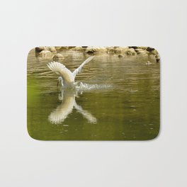 The heron lays on the placid river... Bath Mat