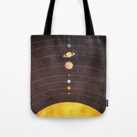 solar system Tote Bags featuring Solar System by Annisa Tiara Utami