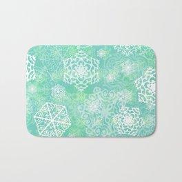 Snowflakes - green Bath Mat