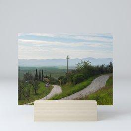 Winding roads in green hills Tuscany, Italy Mini Art Print