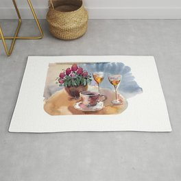 Romantic meeting. Round table of a street cafe with a cup of coffee, liqueur and flowers in a pot  Rug