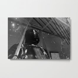 Medieval suit of armor stands watch in a museum Metal Print