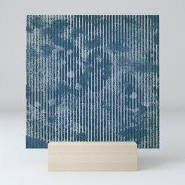 White stripes on grunge textured blue background Mini Art Print
