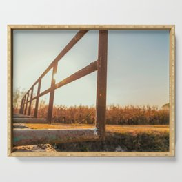 Bridge over an irrigation channel of the Lomellina at sunset Serving Tray