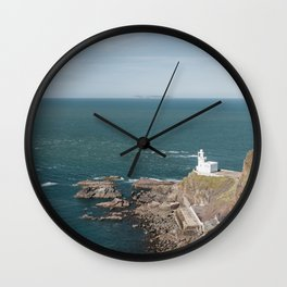 Lighthouse at Hartland Quay with Lundy Island beyond. Devon, UK. Wall Clock