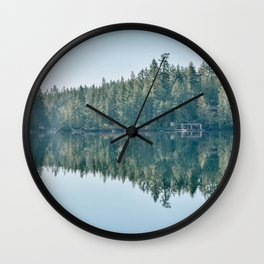 Forest reflection on a lake Wall Clock