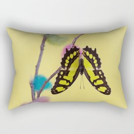 Tropical butterfly sitting upside down on the colored bush over yellow background Rectangular Pillow