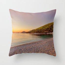 The sunset at the beach Panormos of Skopelos island, Greece Throw Pillow
