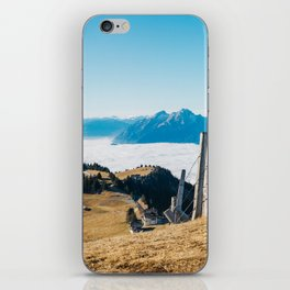 Alpine Peaks Sticking Out of Sea of Fog iPhone Skin