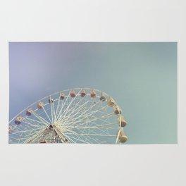 Ferris wheel against a blue sky with vintage film simulation Rug