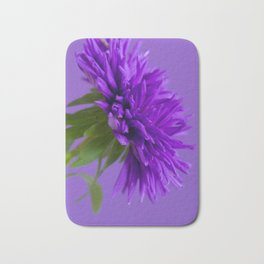 Close-up image of the flower Aster on purple background. Shallow depth of field. Bath Mat