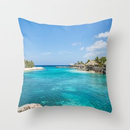 Blue water lake with huts and palm trees around Throw Pillow