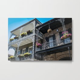 Beautiful Traditional Houses with Intricate Balconies and Baskets Filled with Blooming Spring Flowers in the French Quarter of New Orleans, Louisiana, USA Metal Print