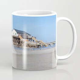 House on stilts at the beach of St. Peter Ording Coffee Mug