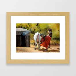 A painting of a maasai woman Milking and a Moran beside Framed Art Print