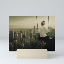 Little Girl Swinging Out Over The City Mini Art Print
