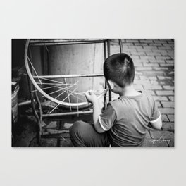 Kid playing in the street Canvas Print