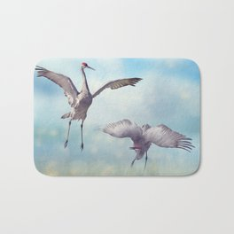 Pair of Sandhill Cranes  dance in the Florida wetlands Bath Mat