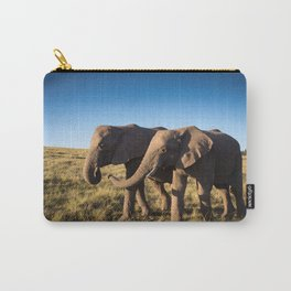 Two happy elephants walking together in African Savannah at sunset Carry-All Pouch