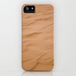 Rippled texture of orange desert sand on windy day iPhone Case