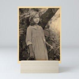 Doris Ulmann  (1882–1934), Girl in ringlets, ribbon, and dress, standing in front of tree Mini Art Print