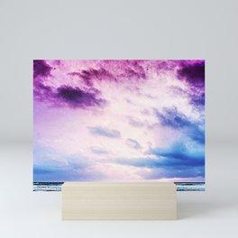 Cloudy shores Mini Art Print