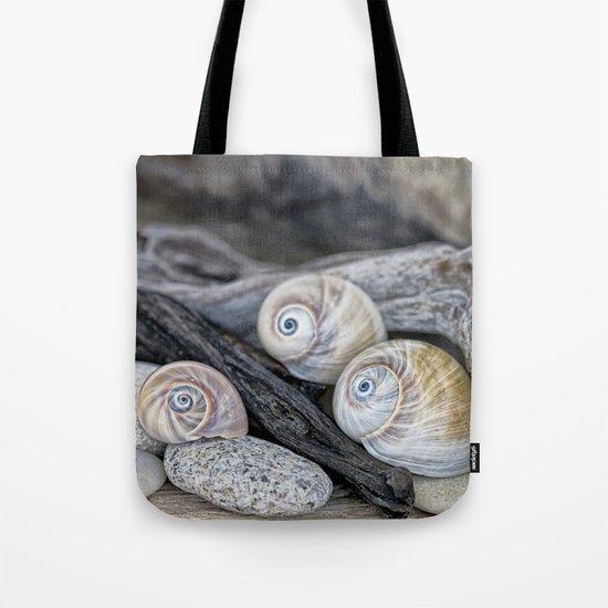 Shark's eye shells and driftwood Tote Bag
