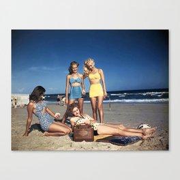 Listening to the radio on the beach, circa 1940s Canvas Print