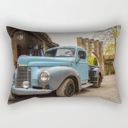 Historic blue-colored pickup parked in the streets of an historic Italian village Rectangular Pillow