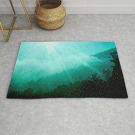 Morning Sun Lights Trough Mountains Clouds - Teal Textured Photomontage Rug