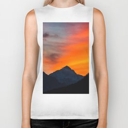 Stunning vibrant sunset behind mountain Biker Tank