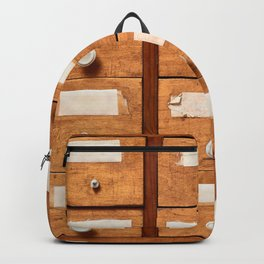 Backgrounds and textures: very old wooden cabinet with drawers Backpack