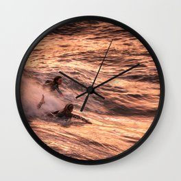 Girls catching a wave together Wall Clock