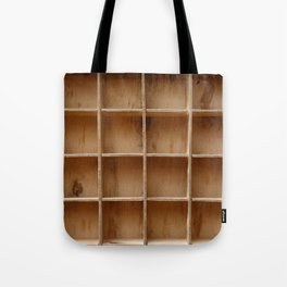 Empty wooden cabinet with cells Tote Bag