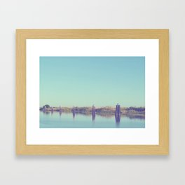 water and pilings Framed Art Print