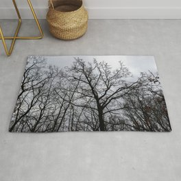 Scary tree, eerie forest, cloudy sky Rug