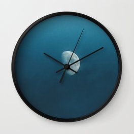 The moon in the sky Wall Clock