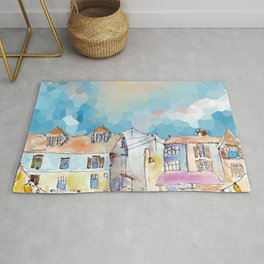 Colorful street in old town under abstract sky Rug