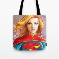supergirl Tote Bags featuring Supergirl by fabvalle