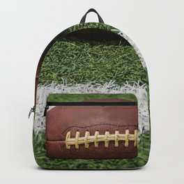 American Football Court with ball on Gras Backpack